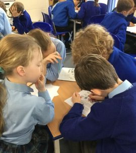 Group of children solving Maths problems